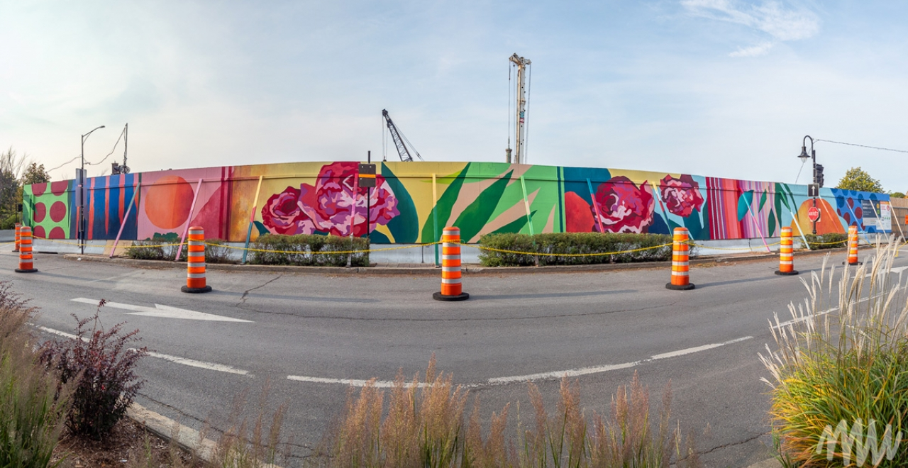 The work We are Roses / Comme des roses by artist Isabelle Duguay, a collaborative project between the Town of Mount Royal, MU and the REM, graces the fence of the future Ville-de-Mont-Royal station construction site.